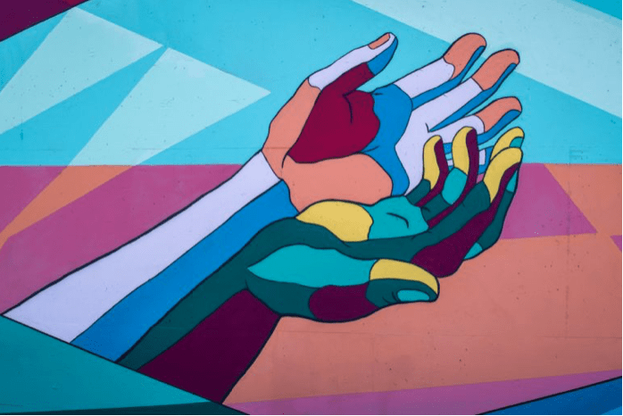 multicoloured hands holding